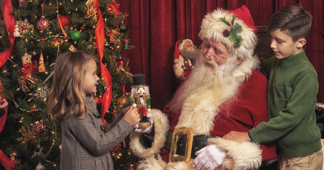 Santa Claus plays with children
